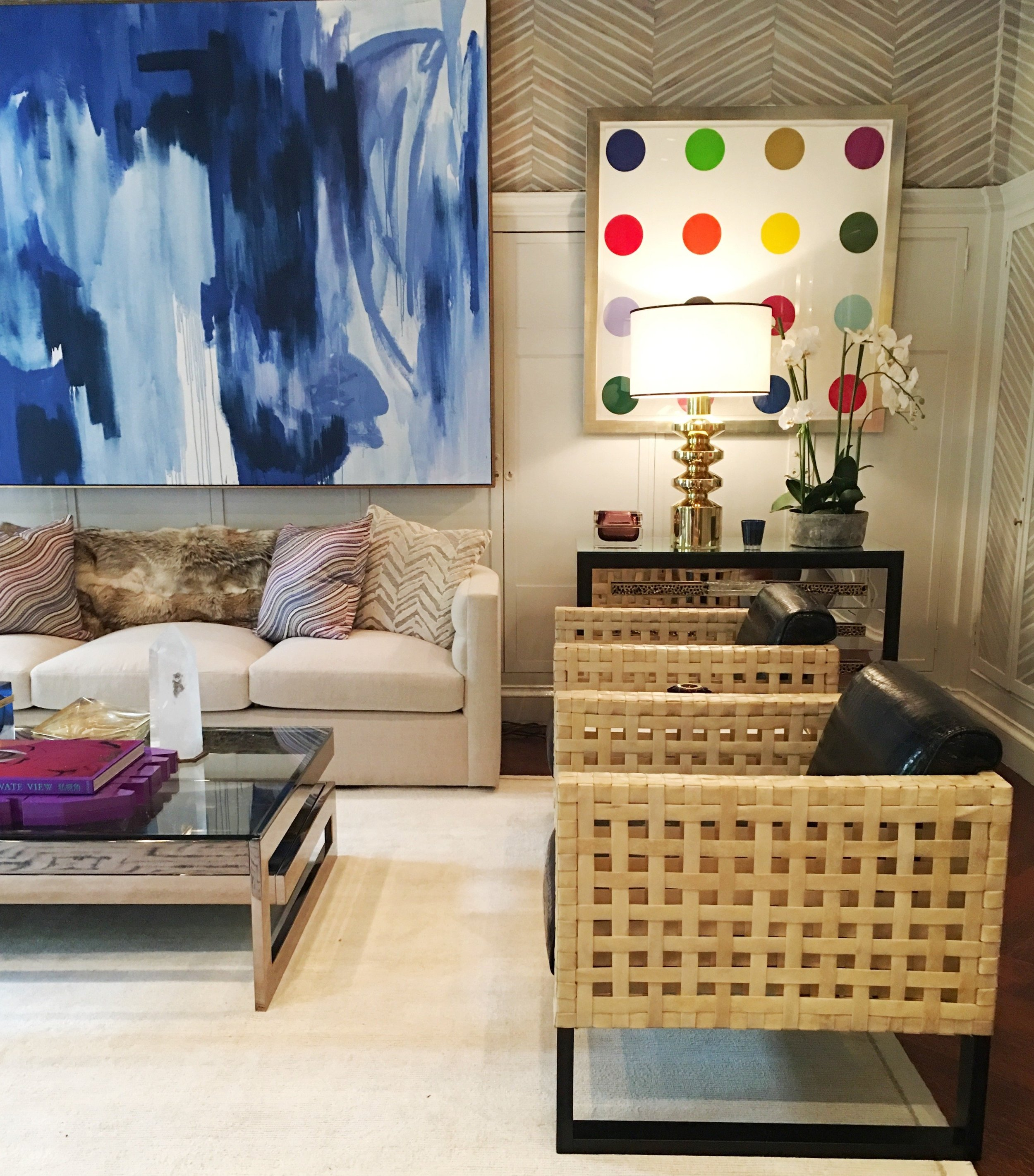 Kirsten Kelli's room in the 45th Kips Bay Show House shows an iconic dot painting by Damien Hirst and part of a lovely blue abstract by Corinne Bizzle.