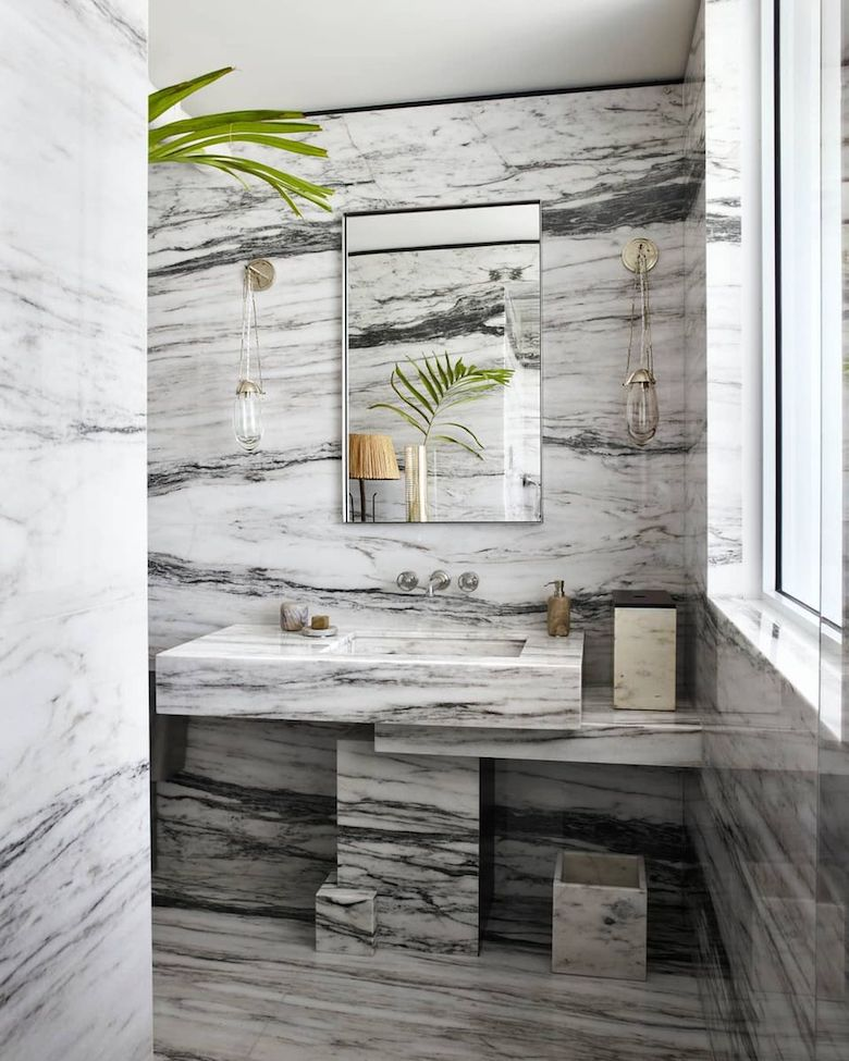 Interior designer Jean-Louis Denoit uses marble slabs when he designed this Miami Beach bathroom.