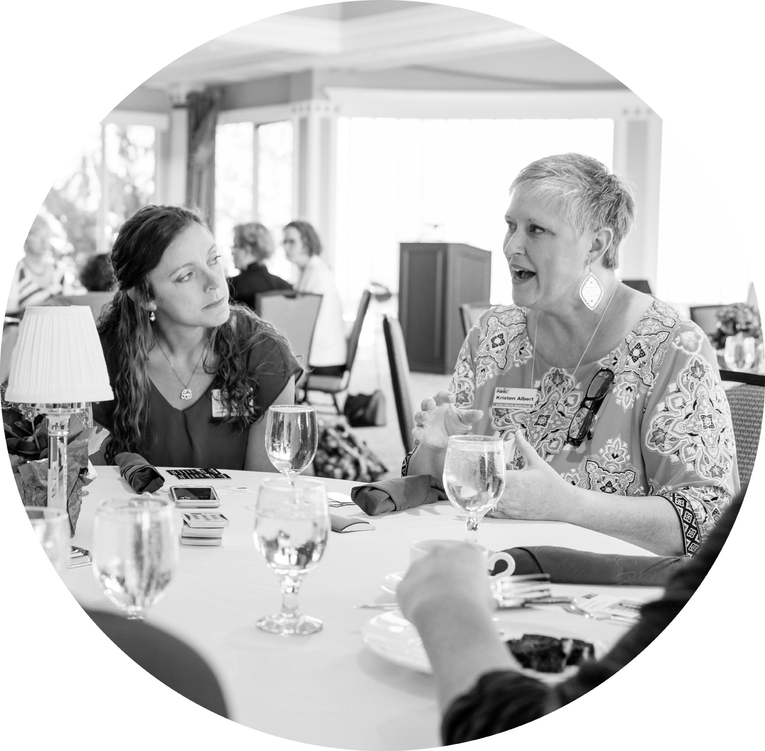 women_eating_at_table_round_BW.jpg
