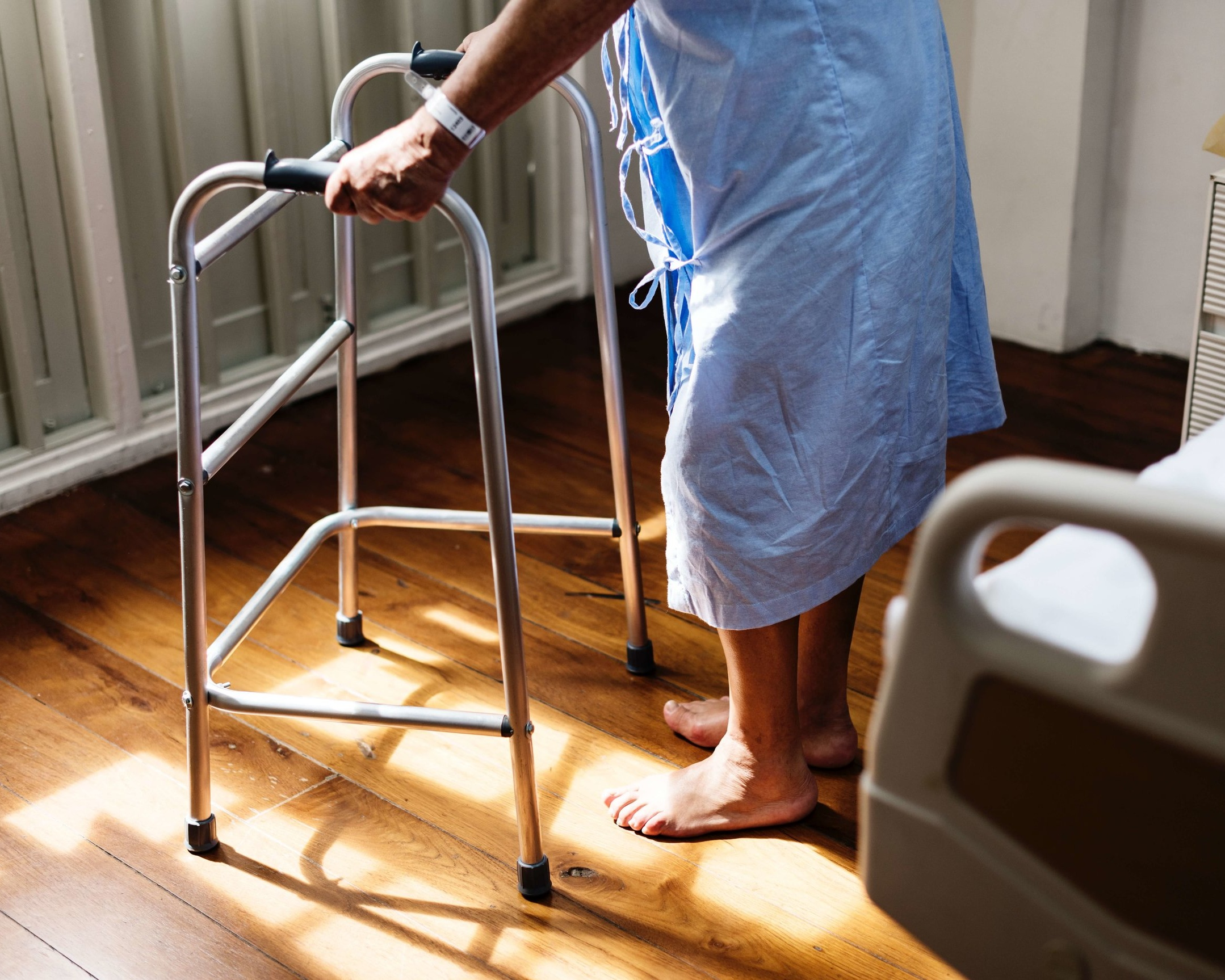 elderly person using a walker at the hospital