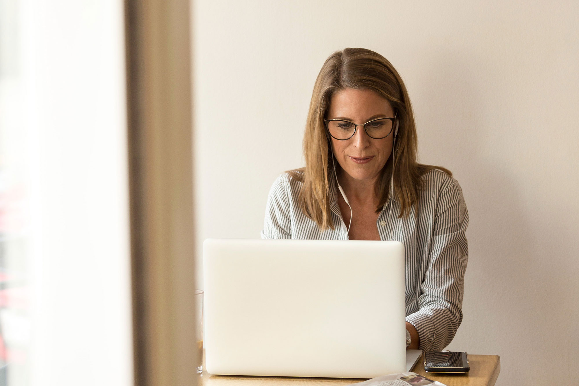 woman doing research on laptop