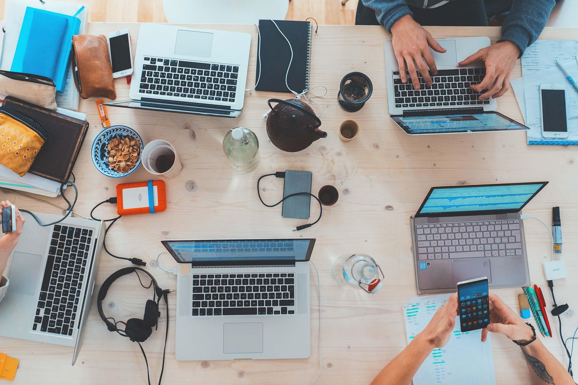 team around computers at work