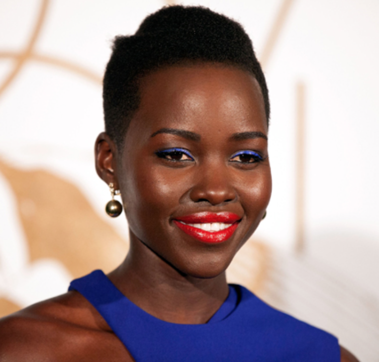 - Deep skin tone like Lupita Nyongo:THE BOLDER, THE BRIGHTER, THE BETTER. Those with deep dark complexions can wear many different shades of red, but if you really want your lips to POP, then wear a brighter color (such as this orange-red) to contrast your dark skin tone.