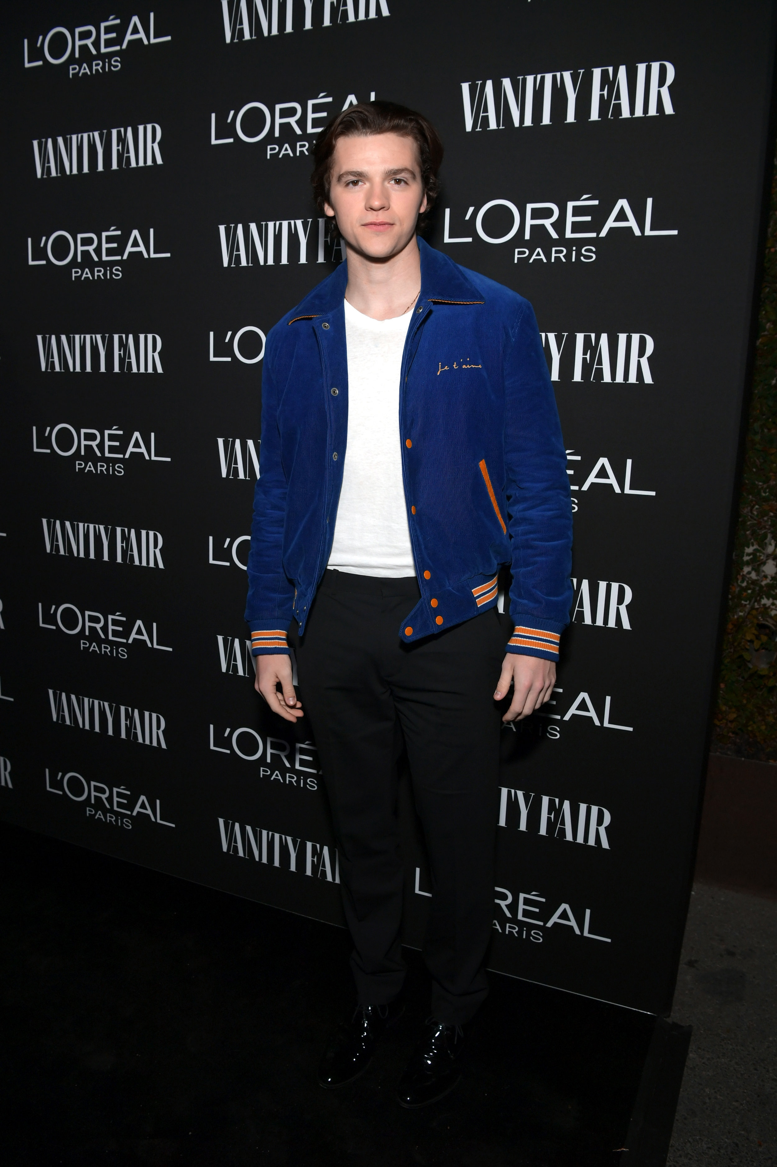 Vanity Fair And L'Oréal Paris Celebrate New Hollywood  WEST HOLLYWOOD, CA - FEBRUARY 19: Joel Courtney is seen as Vanity Fair and L'Oréal Paris Celebrate New Hollywood on February 19, 2019 in Los Angeles, California. (Photo by Emma McIntyre/Getty Images for Vanity Fair).    Joel is wearing a Saint Laurent jacket, Kelly Cole shirt, Theory pants and Calvin Klein shoes.