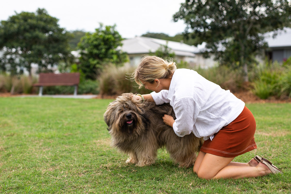 Liv making friends with the furry talent on location for Parklakes 2 social shoot.