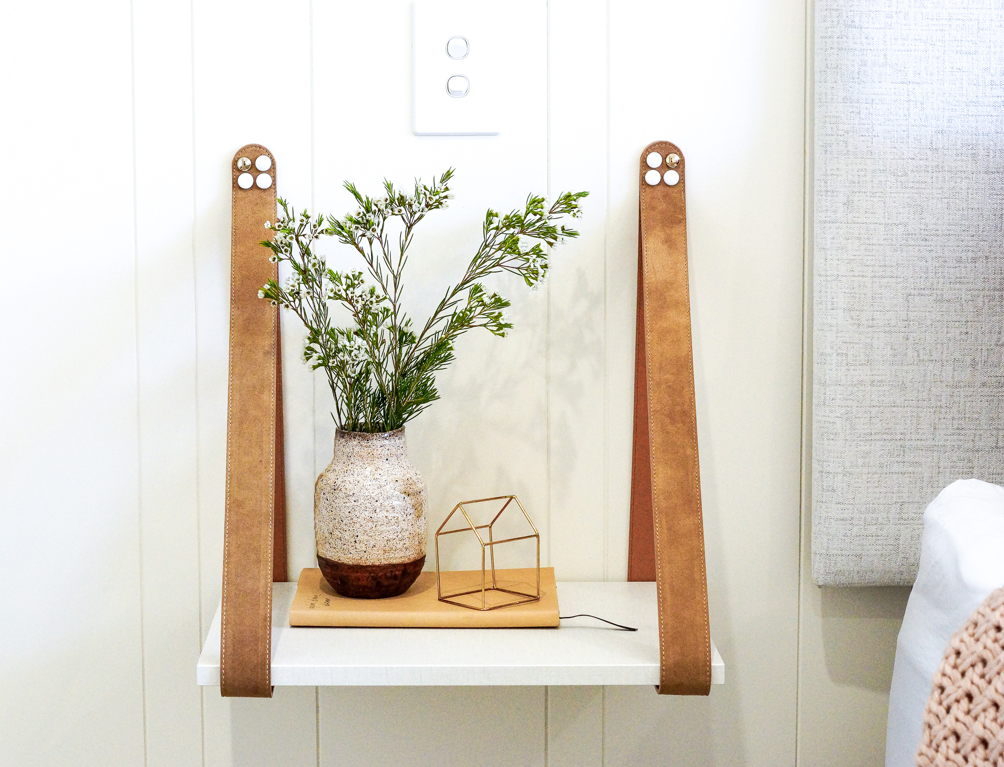 We're loving this leather strap side table!