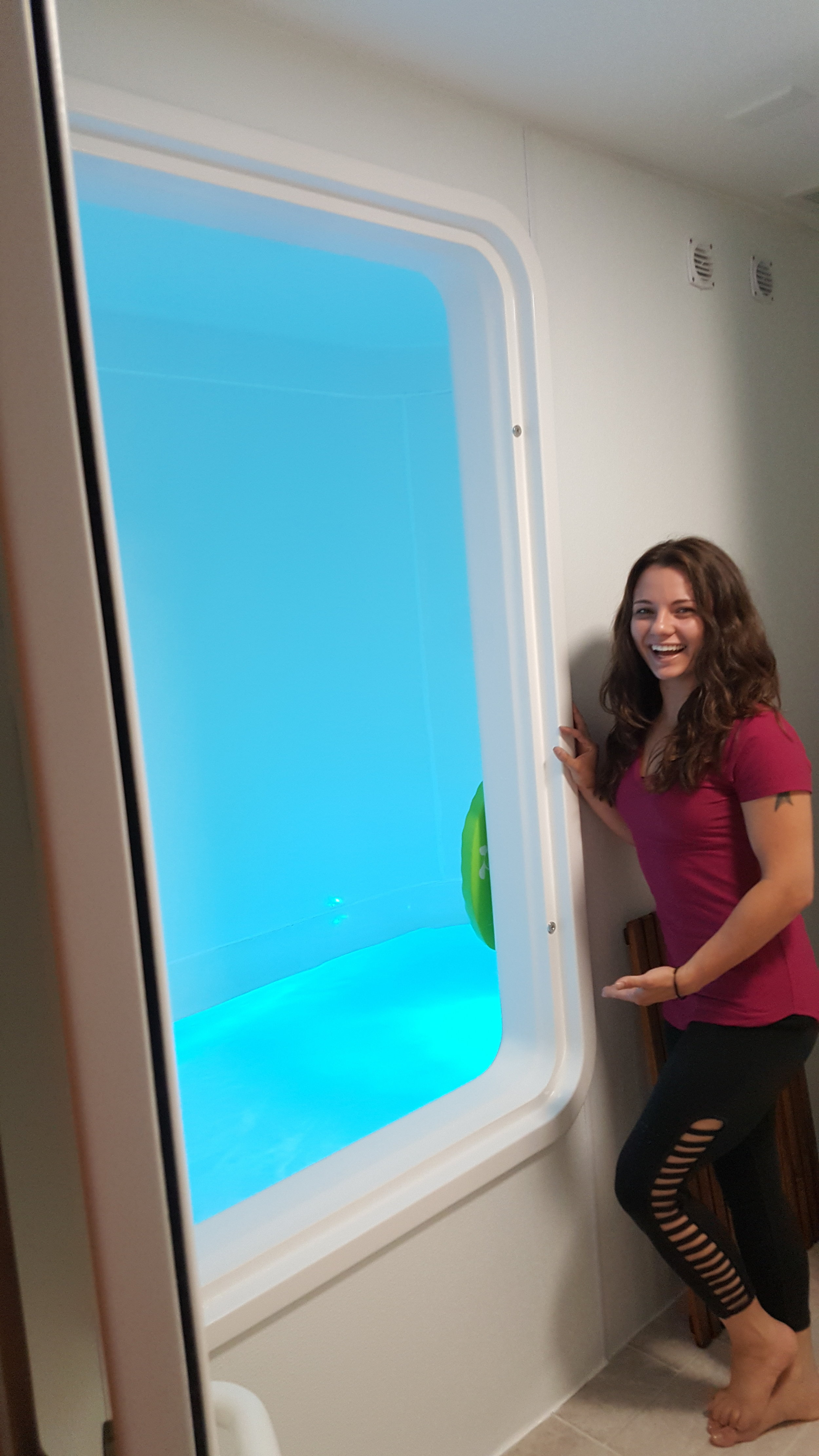 Float tech Stormy Leroux shows off the Float Pod as she trains a client on its features.