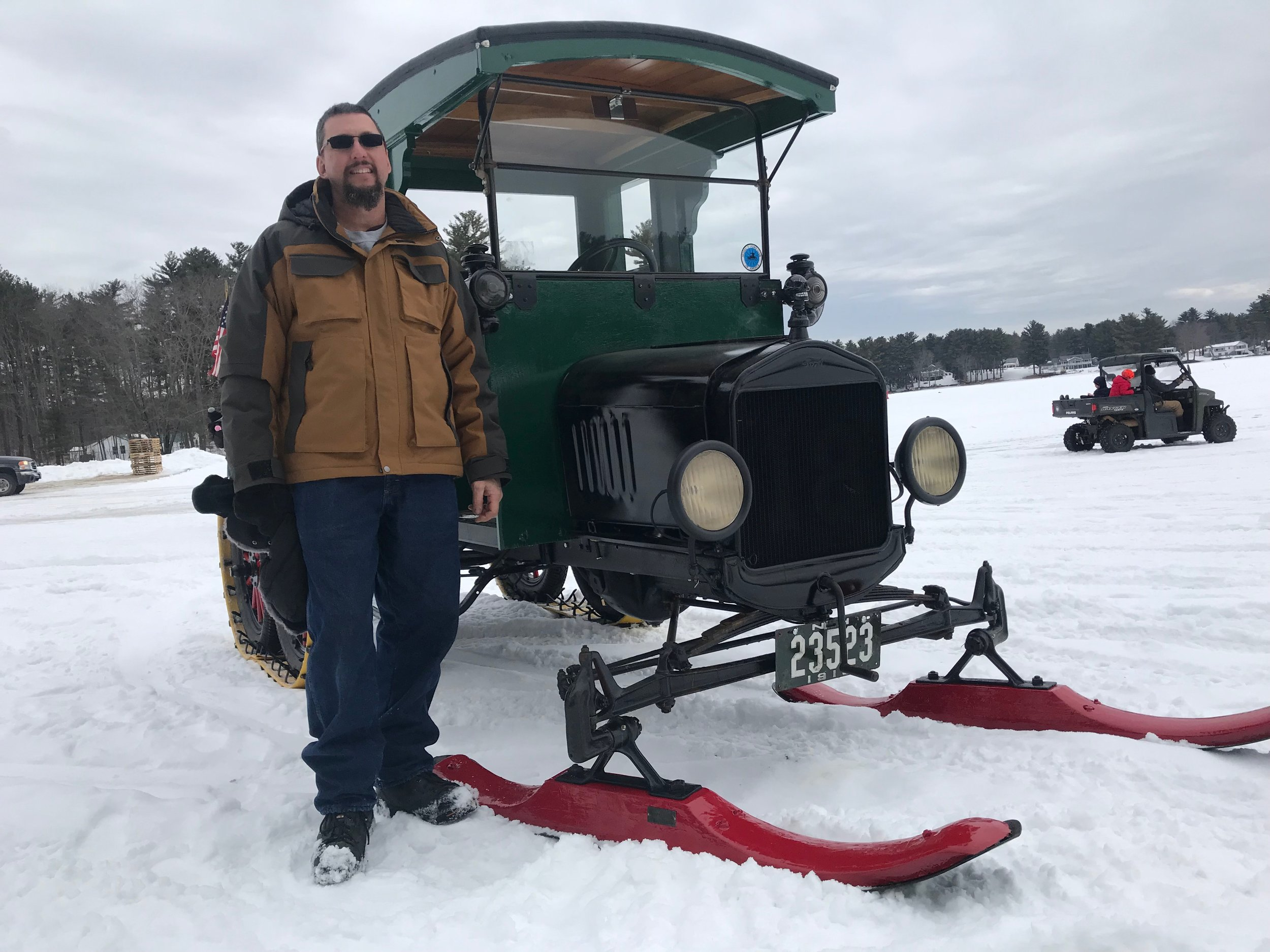 Story & Photos by Mark Foynes - Paul LeBlanc stands proudly by his 1918 Model-T Ford, which has been outfitted with a West Ossipee snowmobile converter kit. He was among the enthusiasts who converged at the Milton Town Beach recently to meet with fellow enthusiasts and provide rides for the general public at no charge.