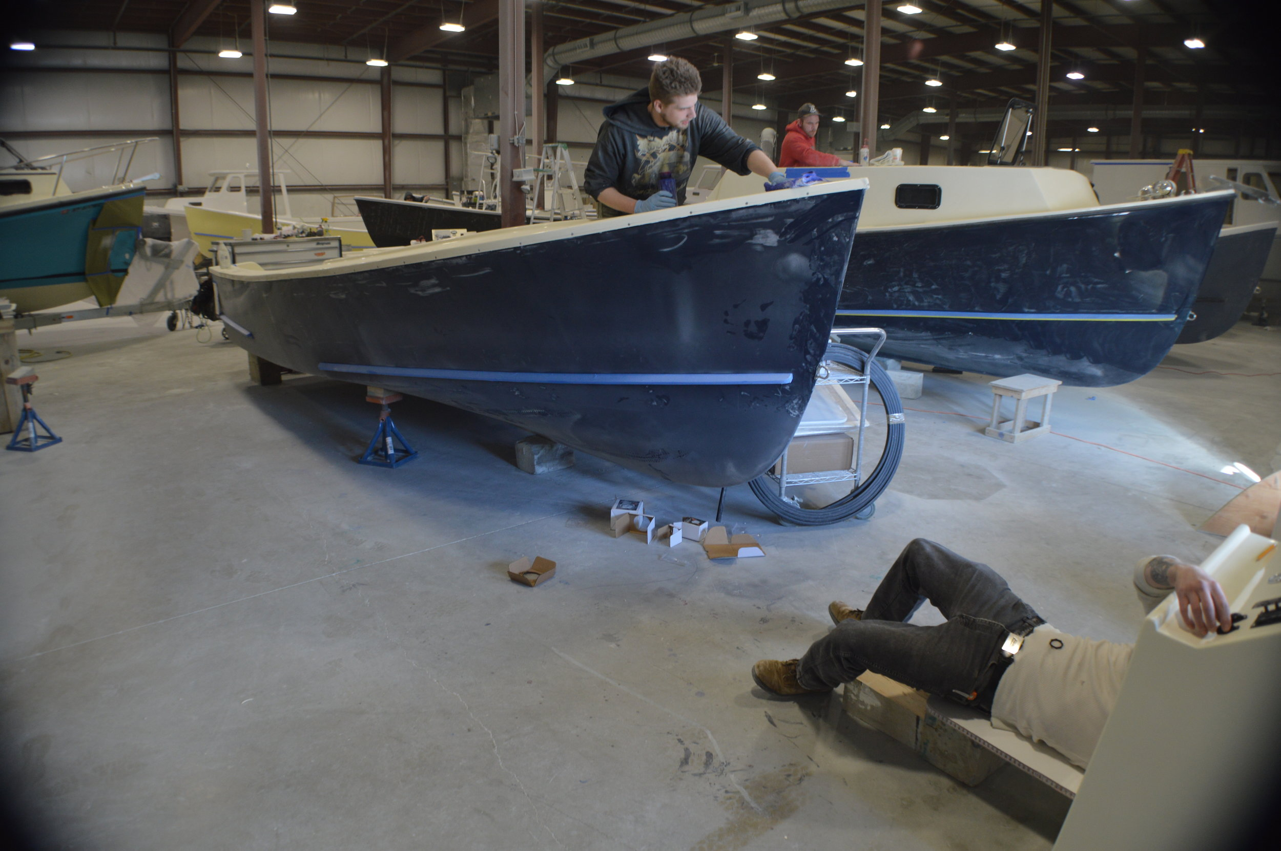 """Eastern Boats in Milton, NH… - has become the """"working man's"""" boat-builder, offering high fuel efficiency and lightweight durability in all their boats. Customized features make them equally attractive for sport-fisherman as for families or on-water emergency services."""