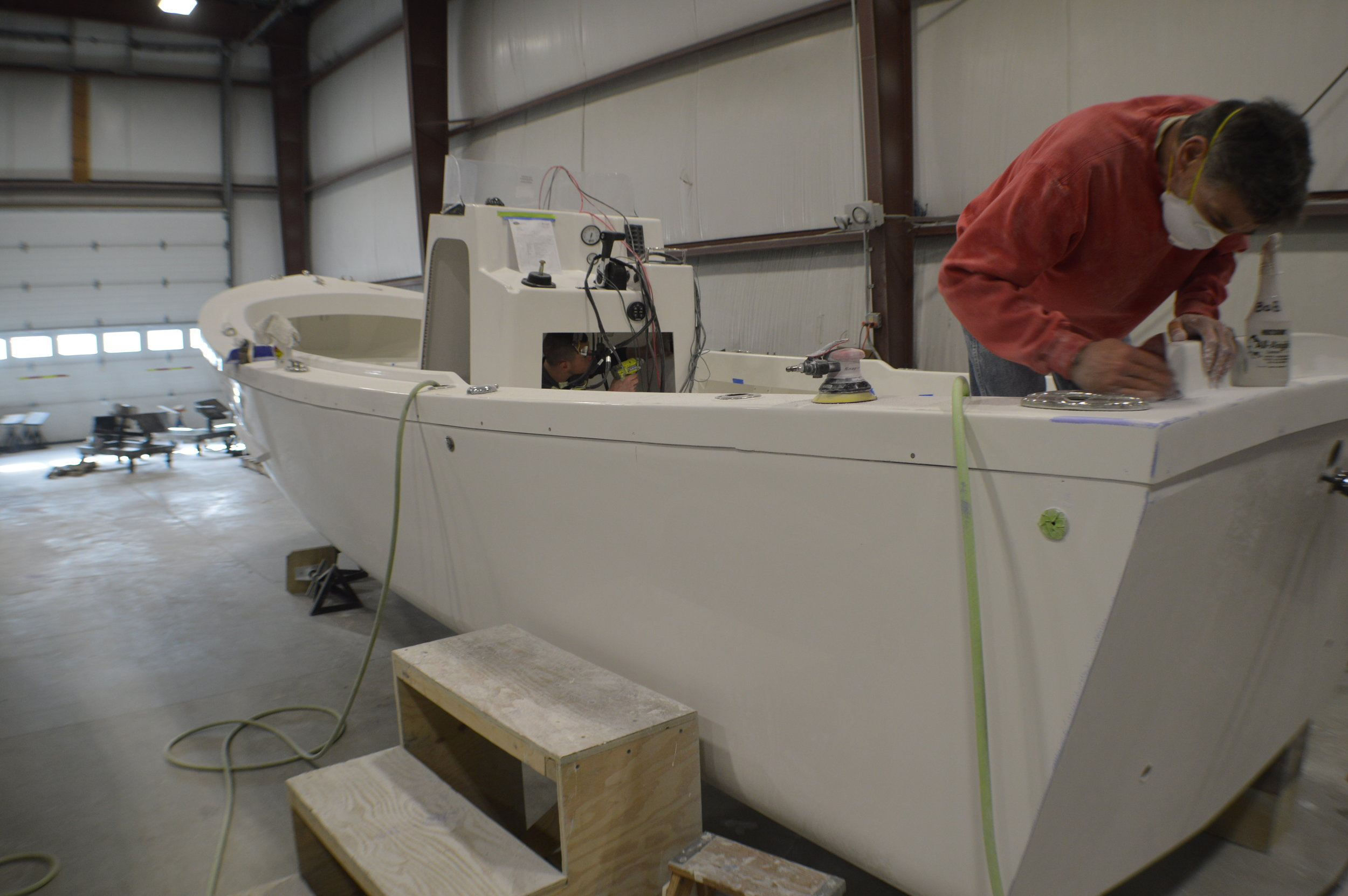 """Eastern's stable core of boat builders is """"the envy of the industry."""" Nearly two dozen of its 45 employees have been with the company for more than 20 years each."""