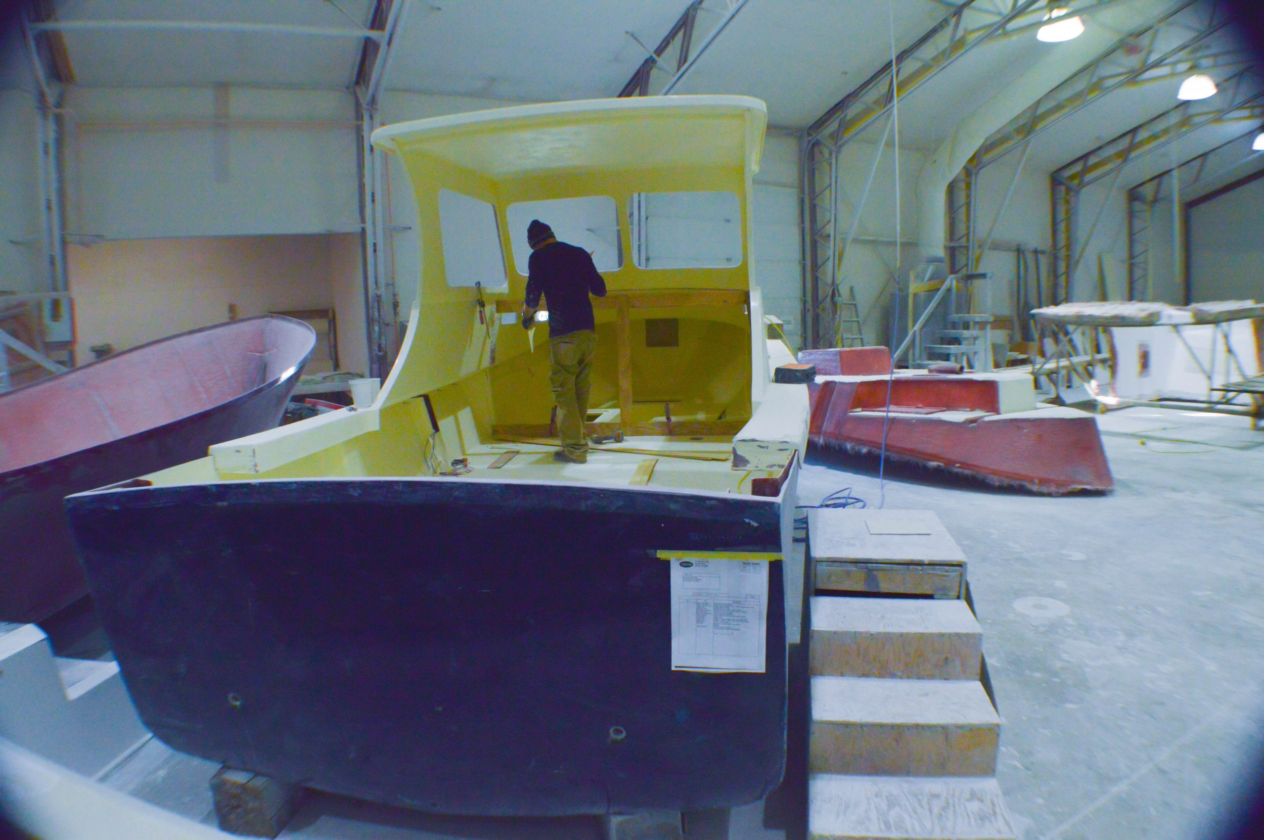 Every boat is built from the outside in. First workers lay up the hull, then the line, and finally the deck.