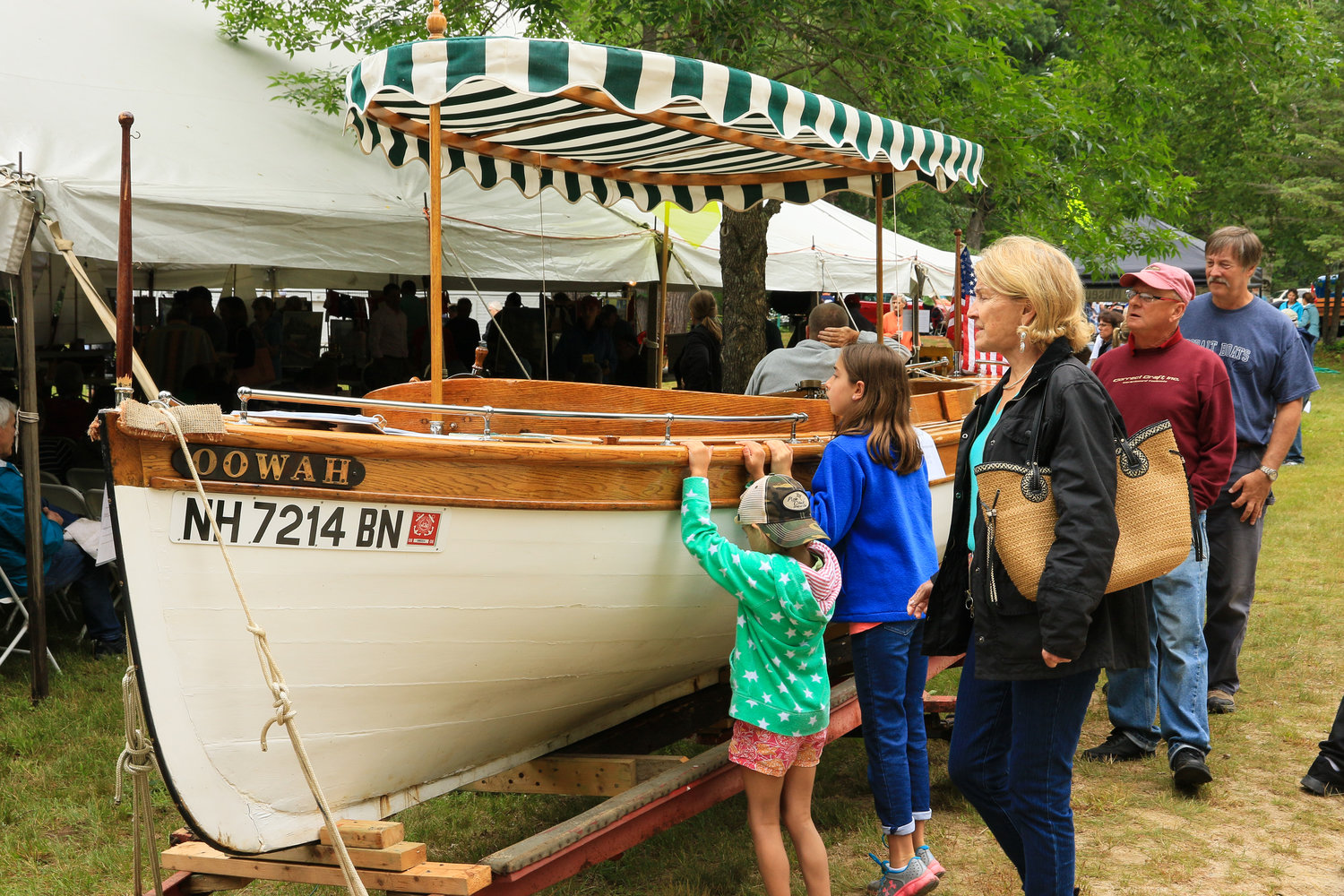 Checking out the boats before the NH Boat Museum's Vintage Boat Auction