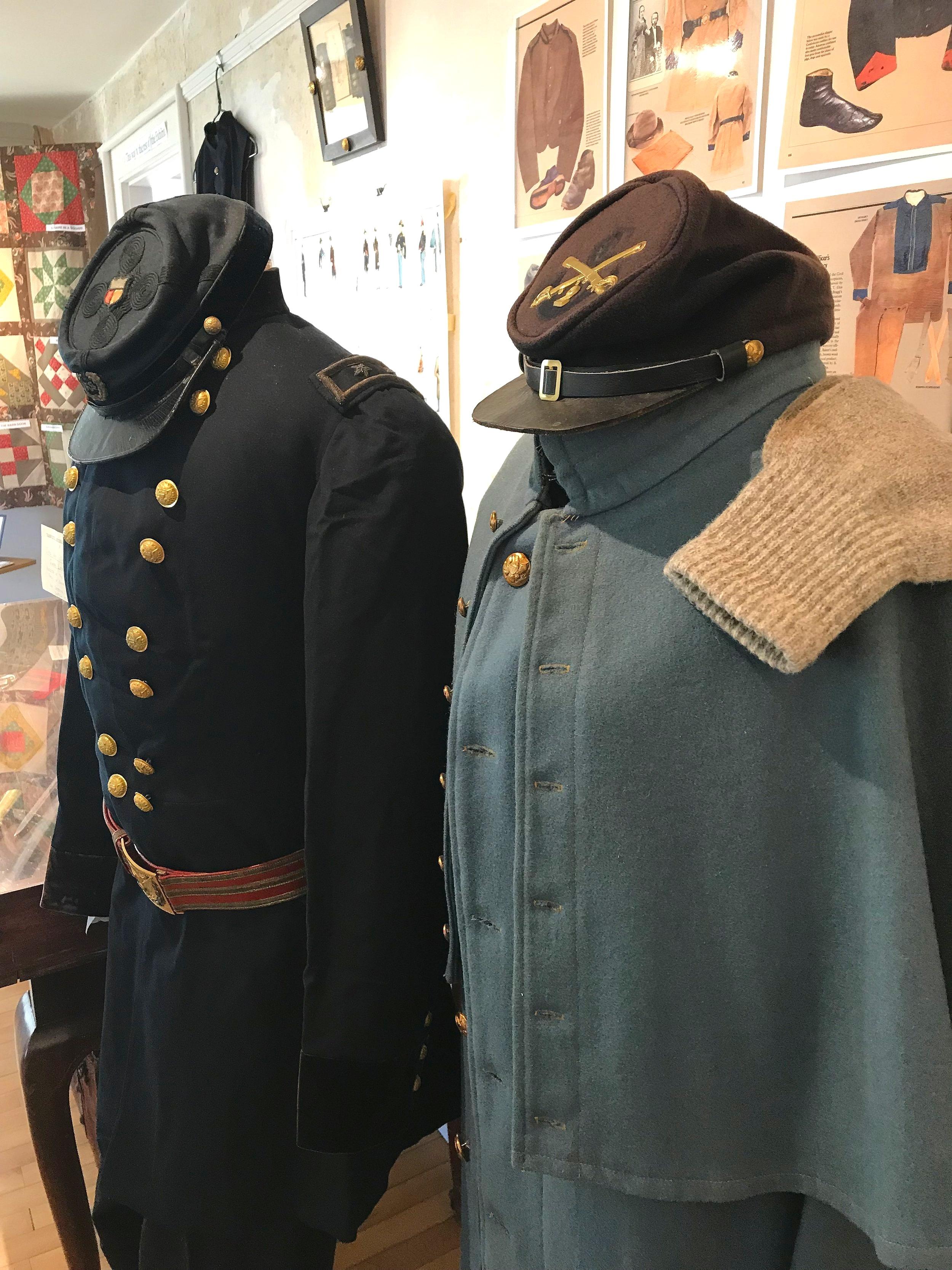 Civil War uniforms in the exhibit.