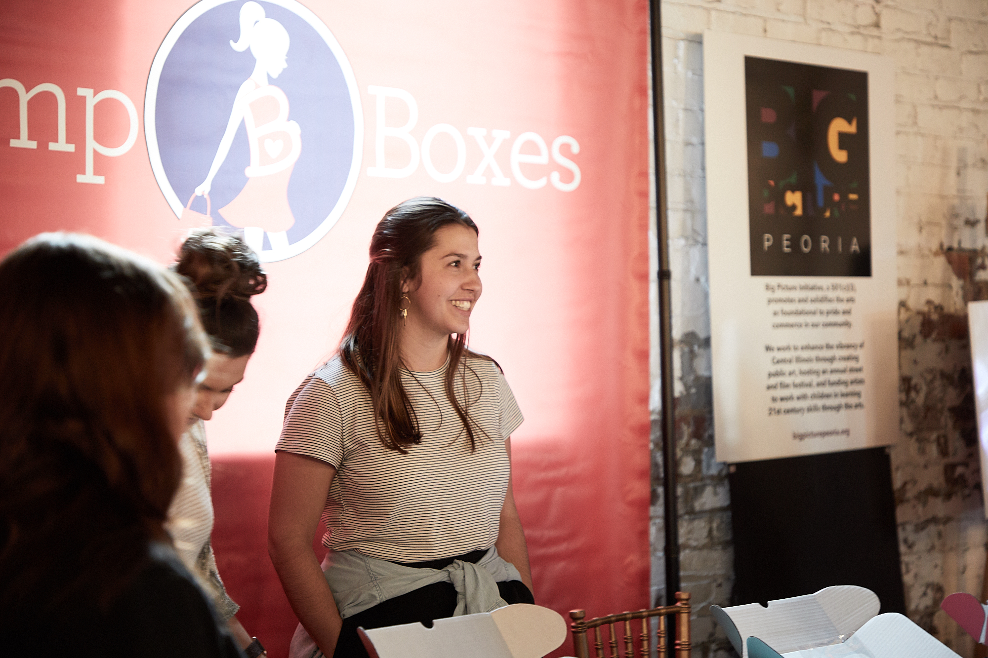 A Bump Boxes employee talks with guests at the Peoria Innovation Alliance launch event.