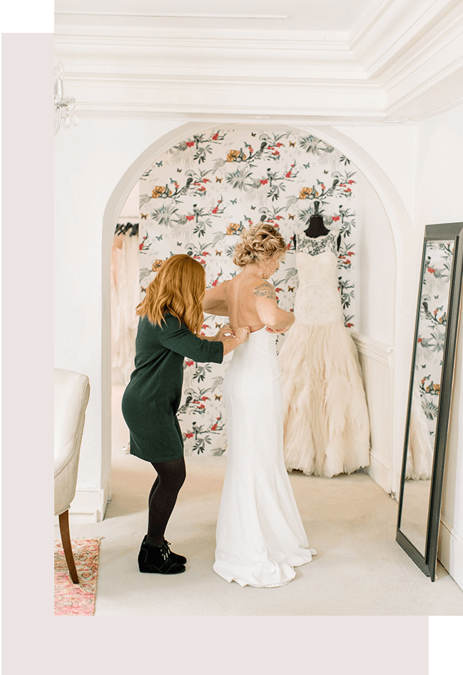 lawton yon helping a charleston bride with her dress at Magnolia Bride.png