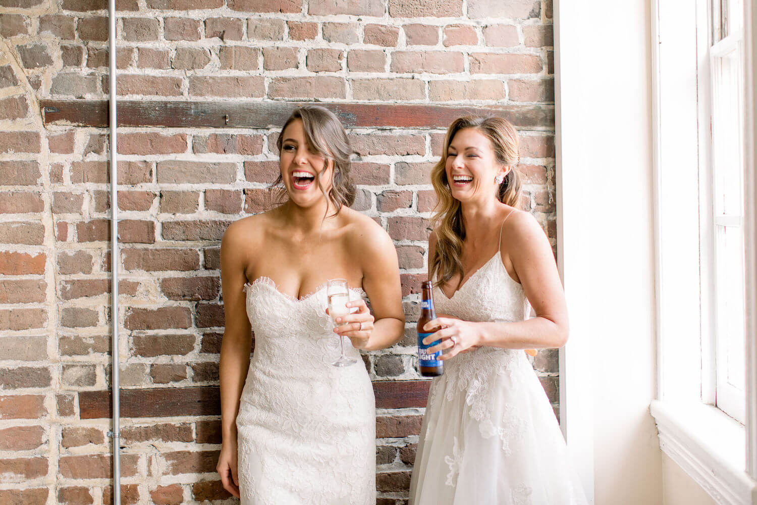 two brides in Monique Lhuillier enjoying the Blind Tiger in Charleston SC.JPG
