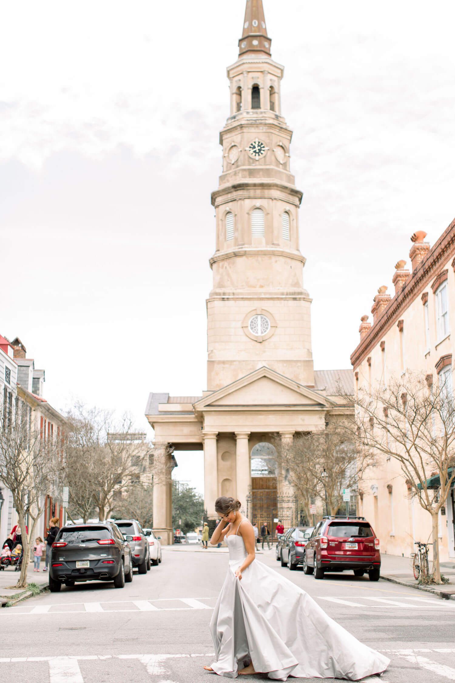 bride wearing Romona Keveza crossing Church Street in Charleston SC.JPG