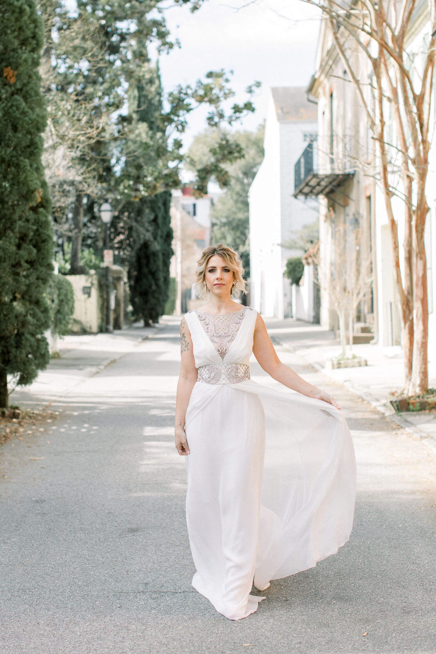 bride in downtown Charleston SC wearing Temperley London bridal gown.JPG