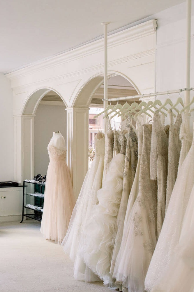 view of bridal gowns in Magnolia bride bridal store.JPG