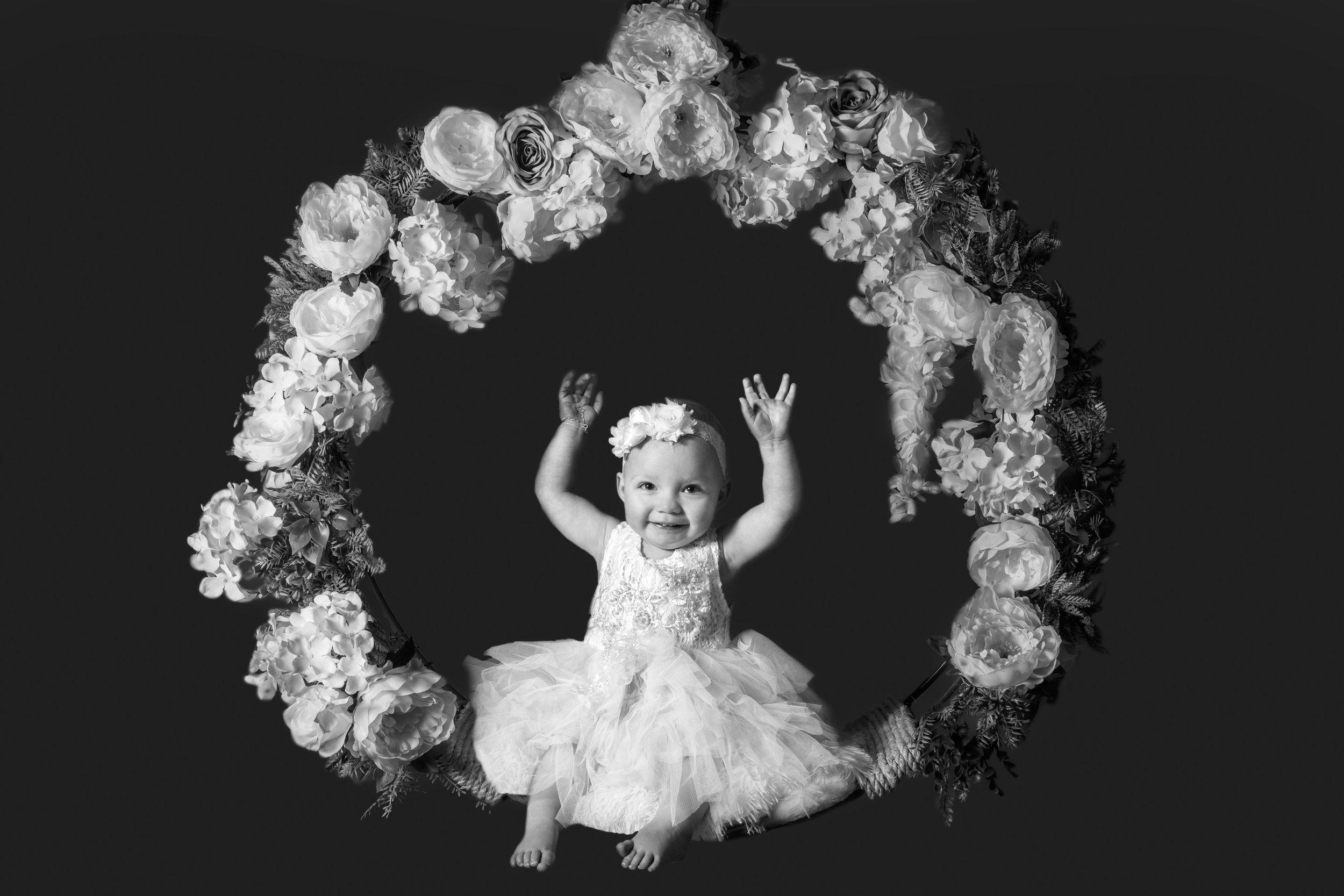 Girl in Flower Swing