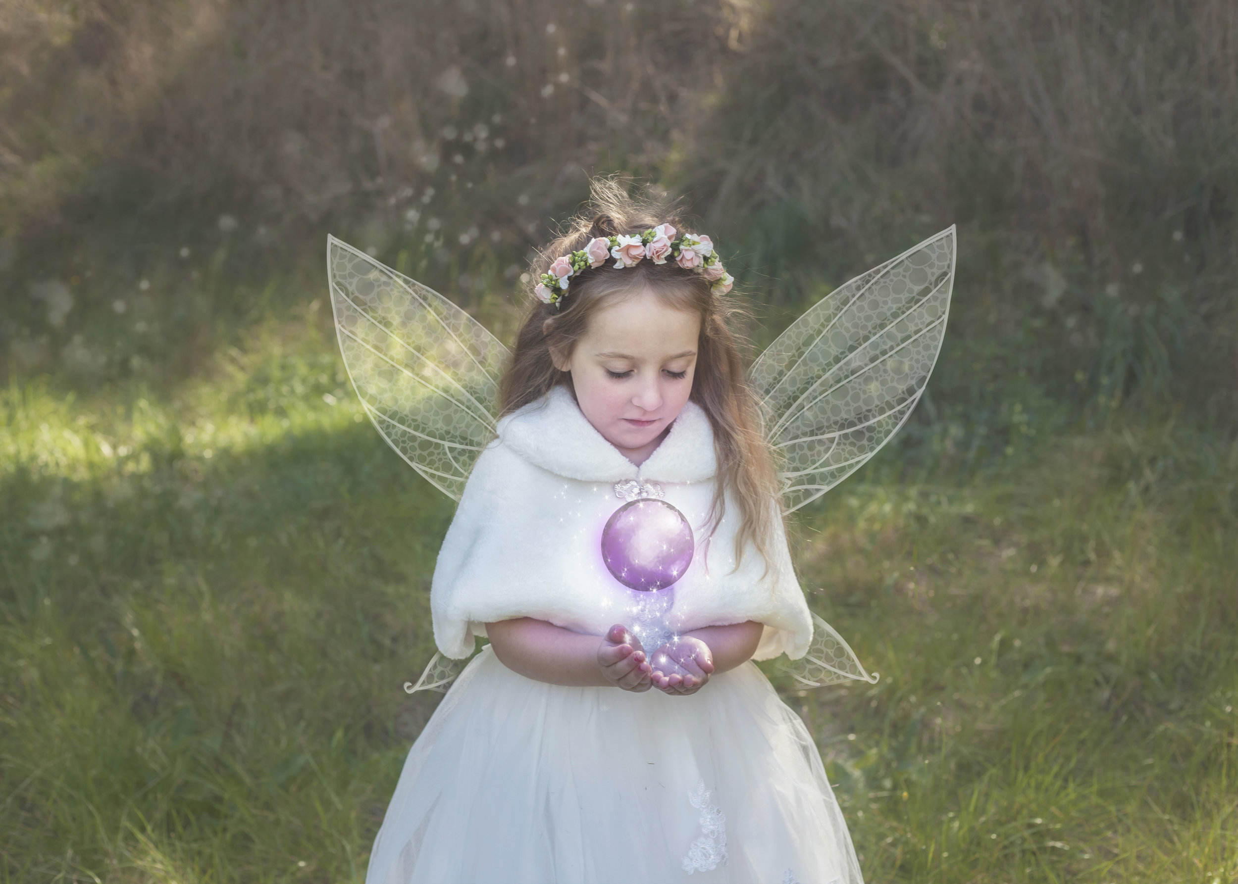 Girl with Fairy Wings and Magic Orb