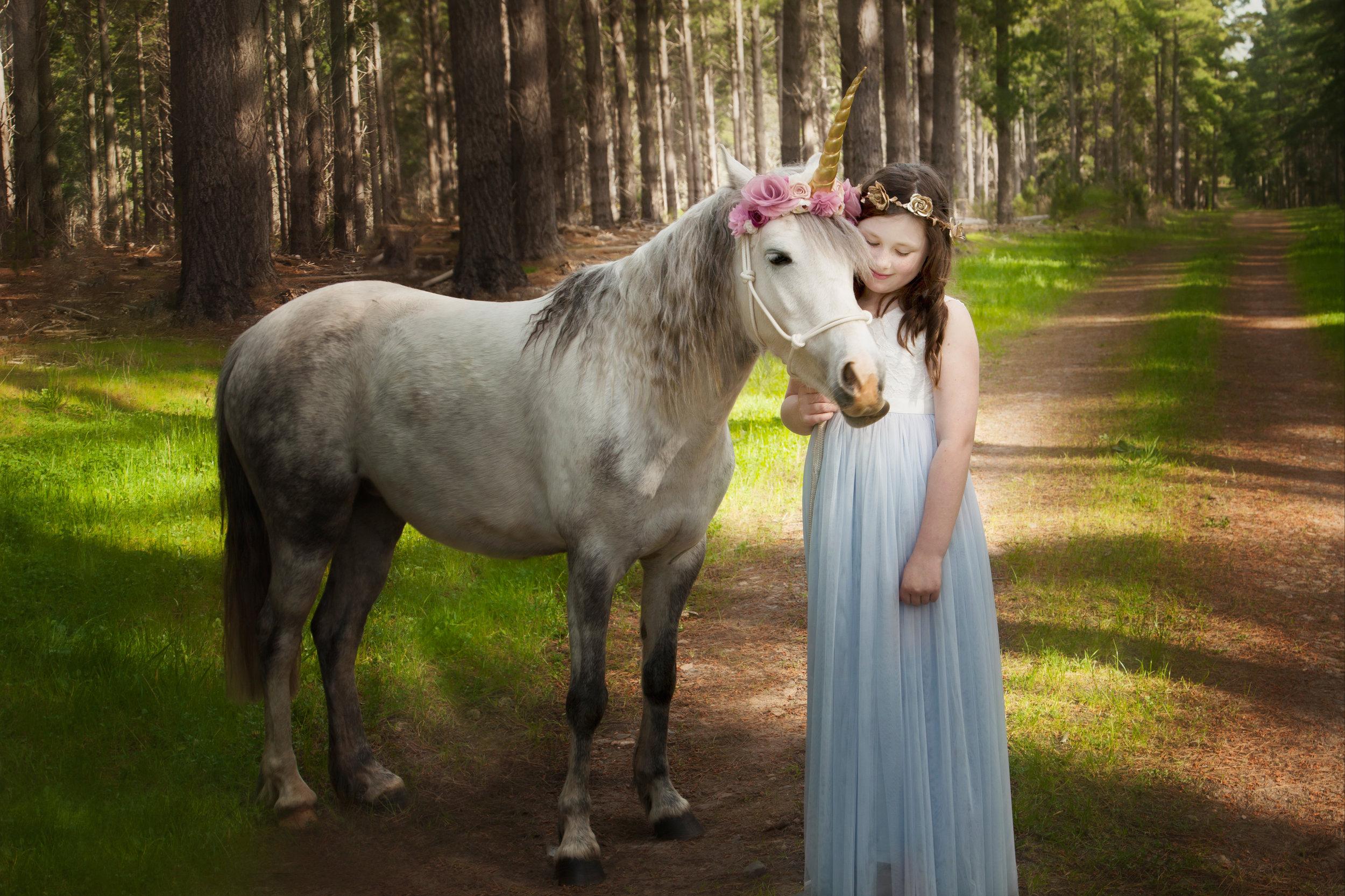 Girl with unicorn pony