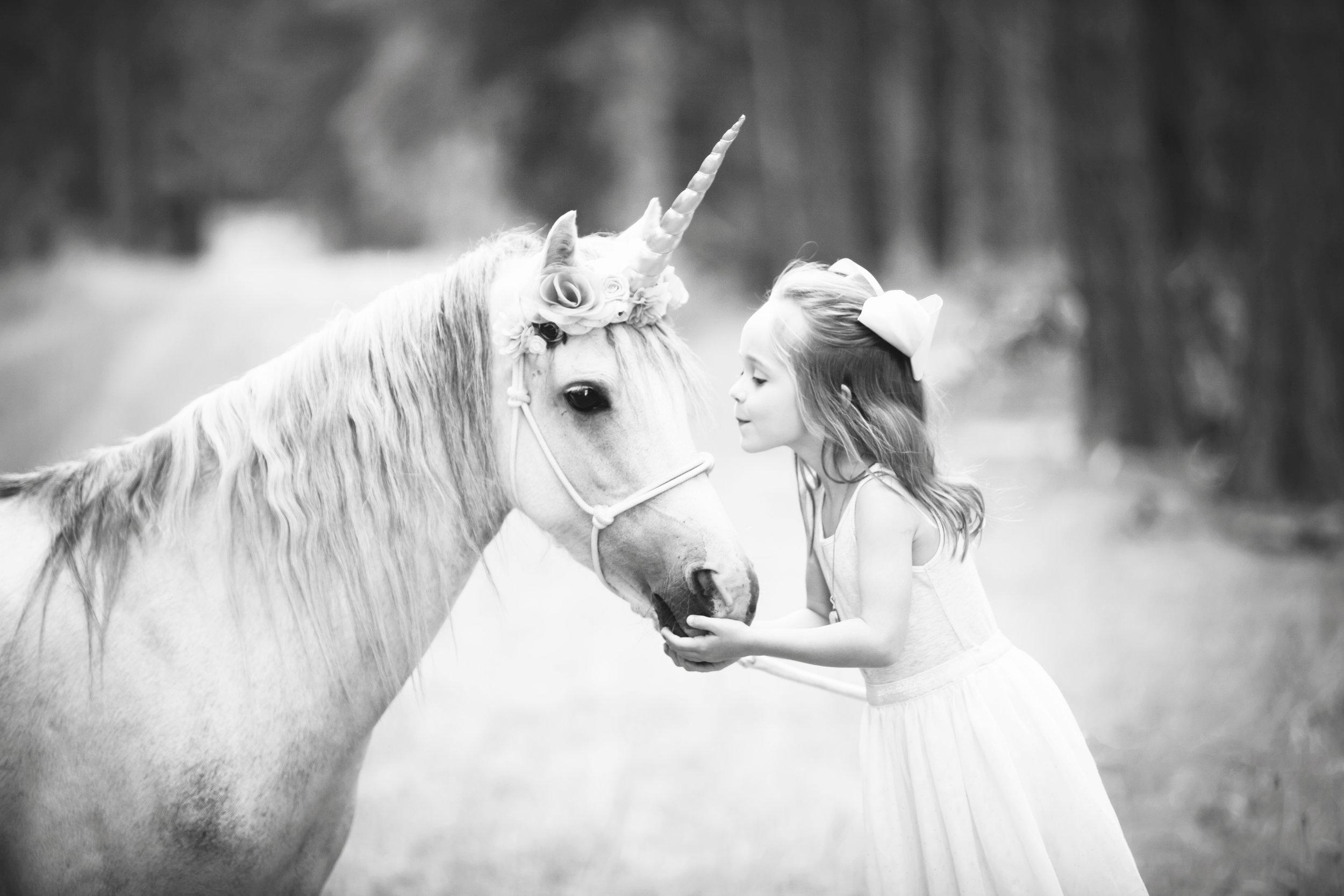 Girl Kissing Unicorn