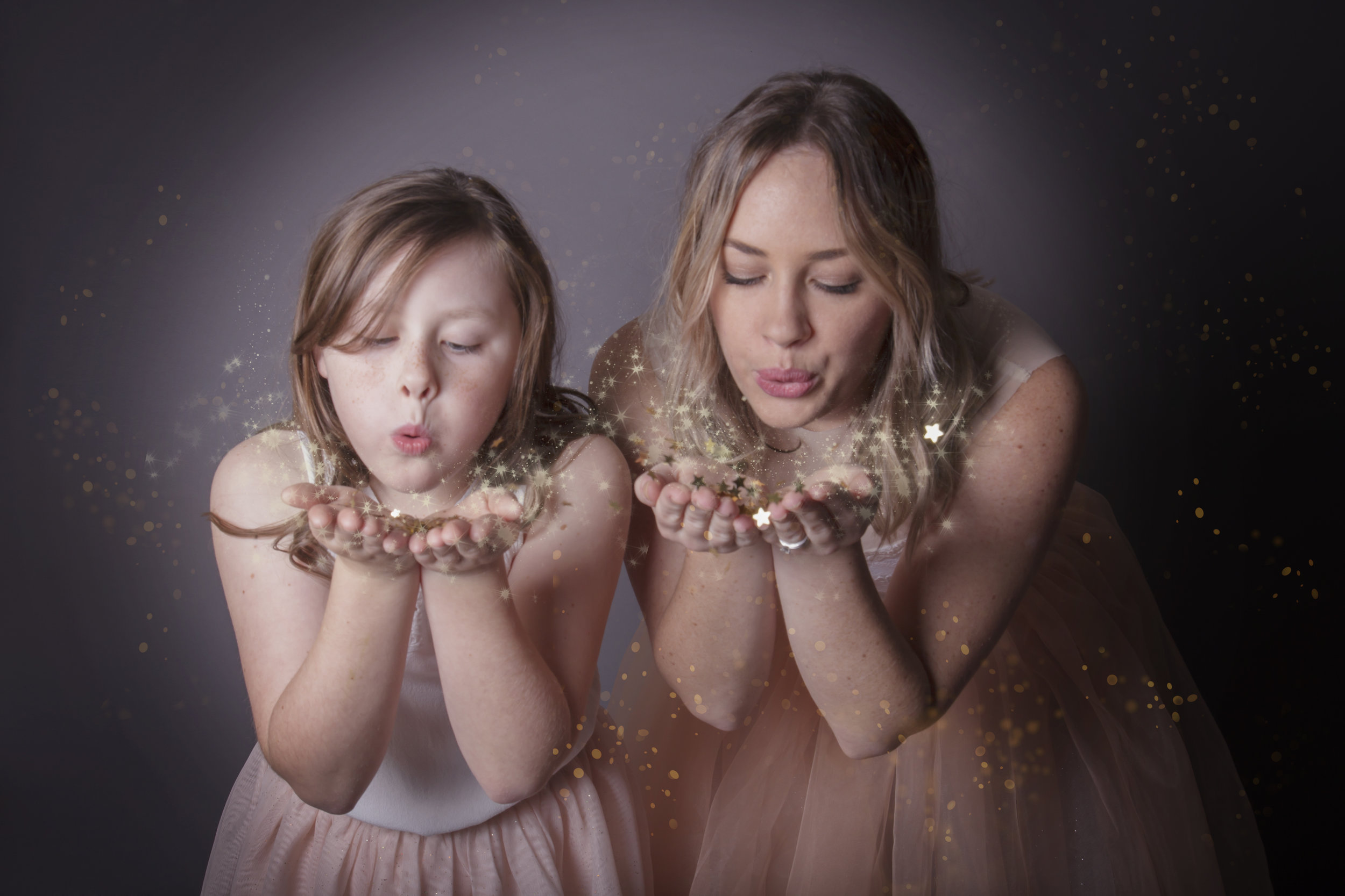 Allegra and Ashleigh blowing glitter in Studio Glitter Sessions.jpg