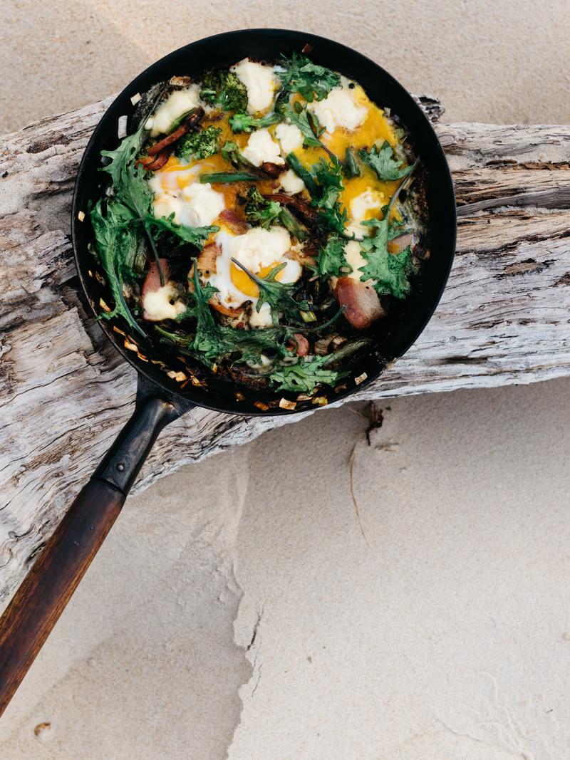 d41a7b1c5c7a1525fd36697c735dfeb13c69da27_recipe-food-fried-greens-smoked-bacon-eggs-beach-final-complete.jpg