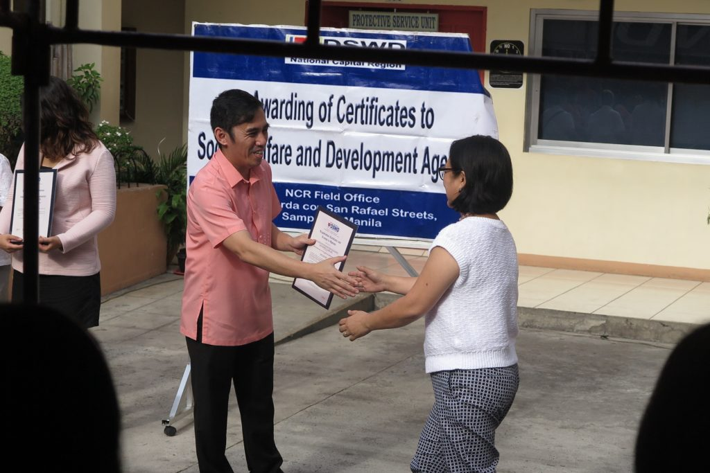 Dr. Mae Corvera receives TRF's Registration Certificate and License to Operate from DSWD NCR Regional Director Vincent Andrew Leyson. The license is valid for 3 years, from January 2017 until 2020.