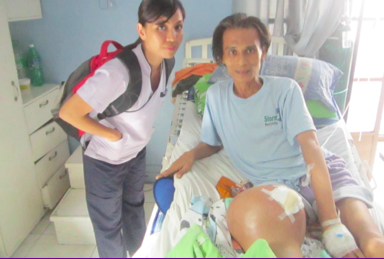 Jonathan with nurse Emma before his successful operation at the PGH