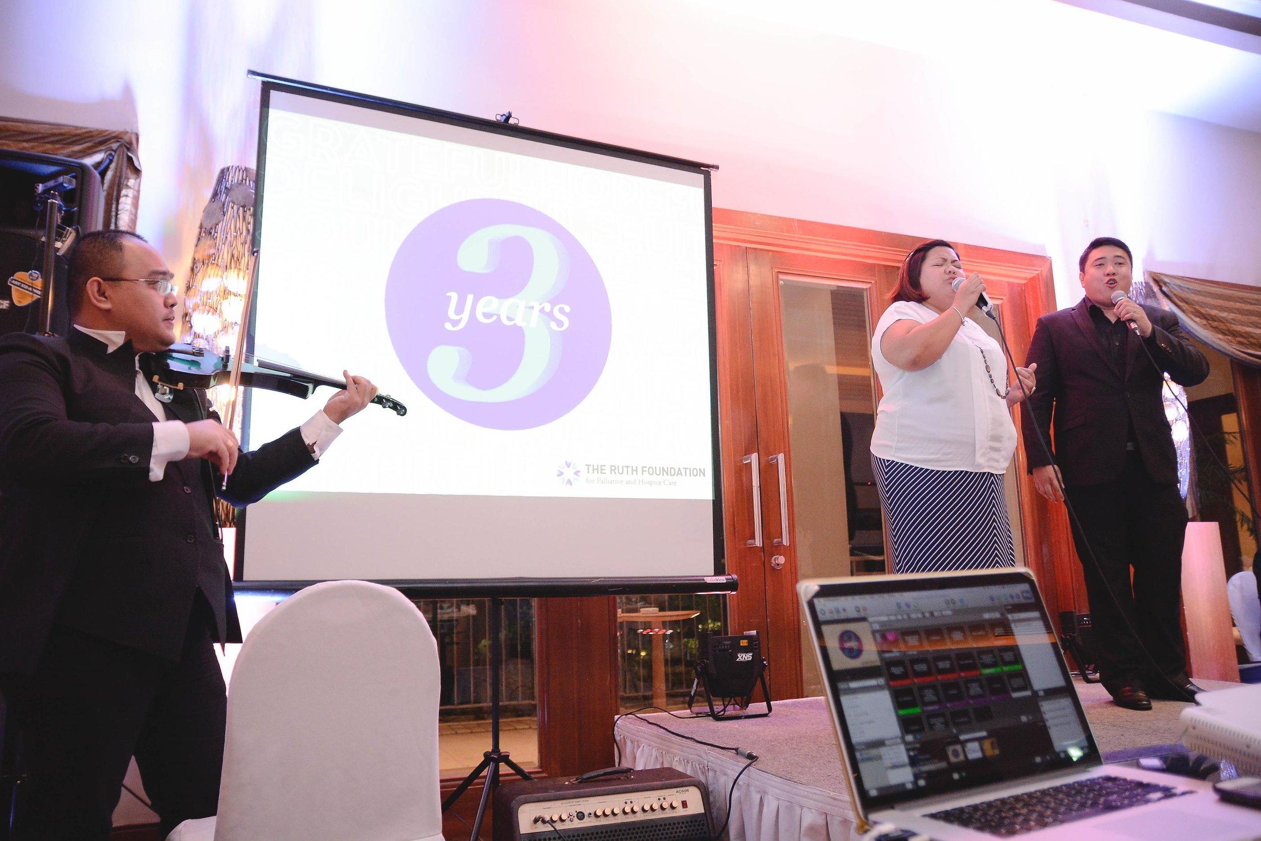 From L-R   : violinist    Merjohn Ligaya   , lyric soprano    Sharon Hernandez   , and Pastor    Spencer Gequillana    serenading the guests with a thrilling rendition of 'The Prayer'