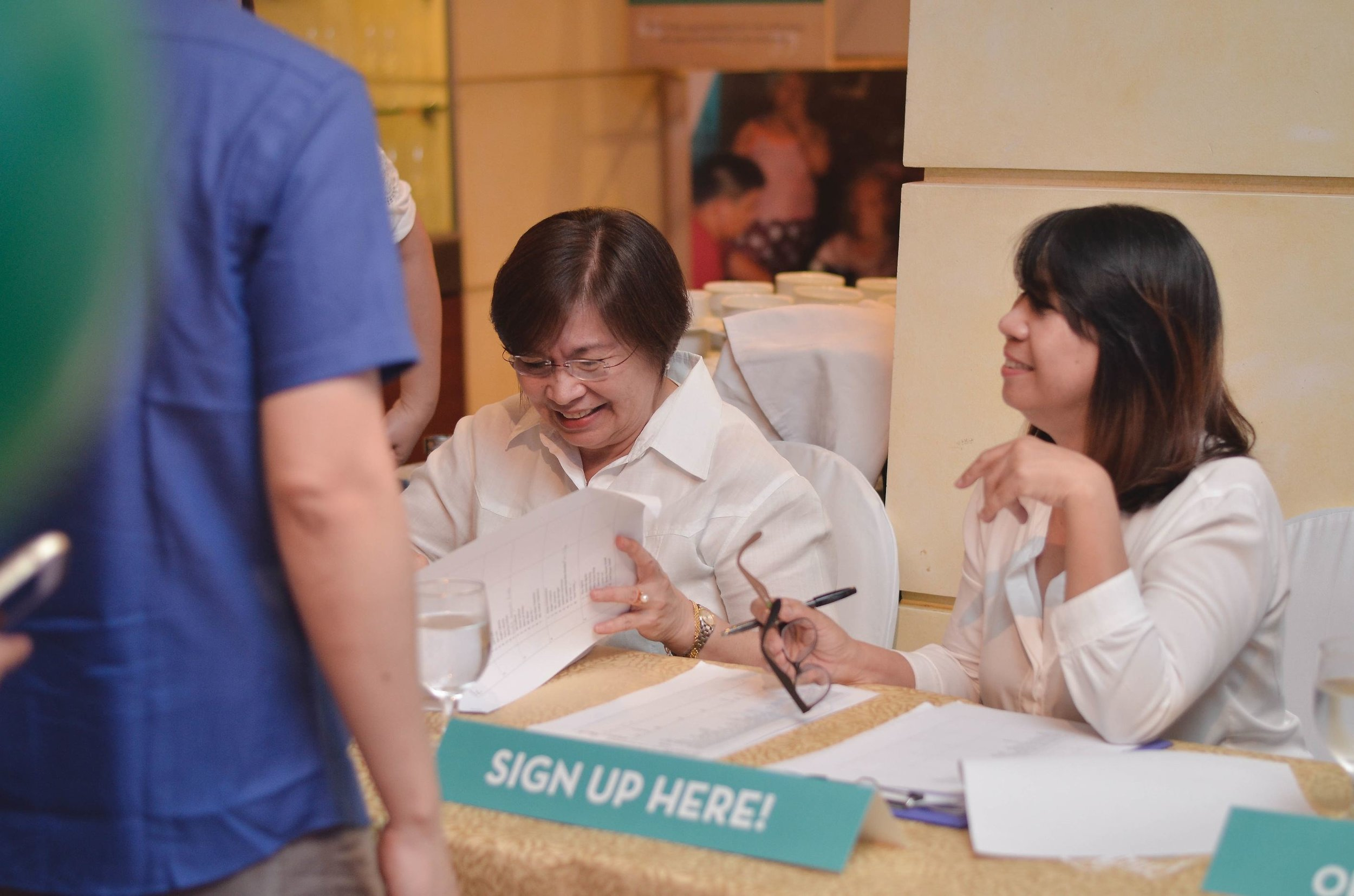 TRF's treasured volunteers helping at the registration booth