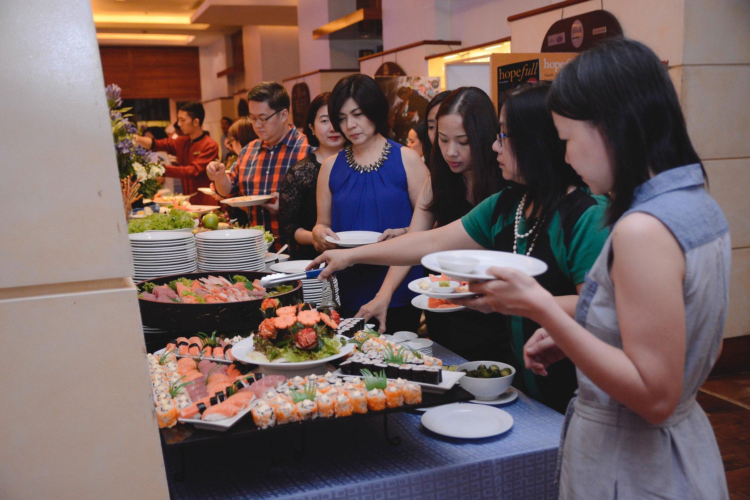 enjoying a sumptuous Japanese-themed dinner spread