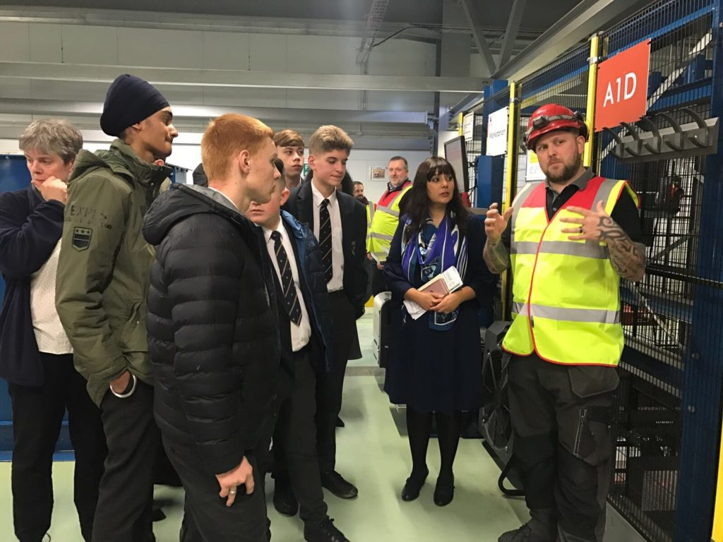 Ms Ghani and Rawlett School students learning about the pallet storage system