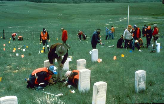 """1984 excavation, flags mark the areas metal detectors and archaeologists found artifacts on """"Last Stand Hill"""""""