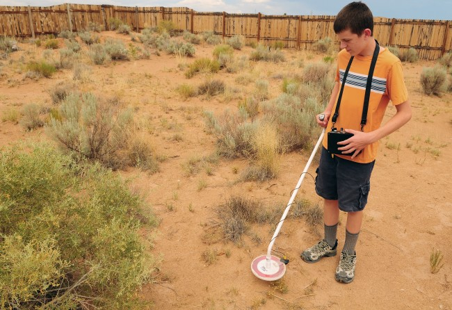 13 year old Jansen Lyons with the metal detector his grandfather made, that discovered the 2 pound Meteorite in Rio Rancho, New Mexico USA!!! Photo ©Albuquerque Journal 2012