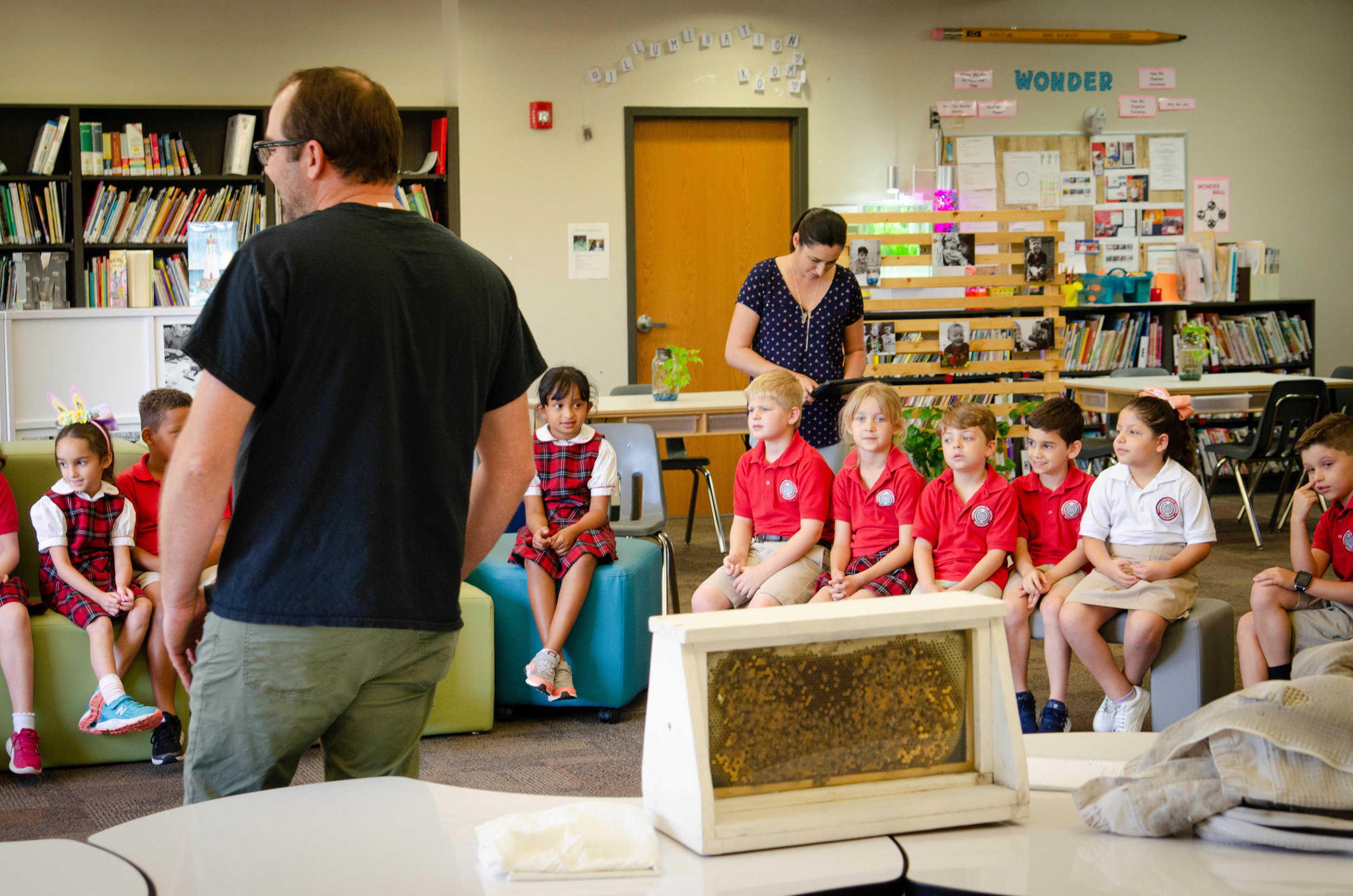 Honeybee Presentations - We love sharing our passion for how amazing honeybees are with others. We use our observation hive to teach students and adults all about how a colony of honeybees works and how important they are in our environment and for pollinating the food we eat. Interested in having us come to your school or event?