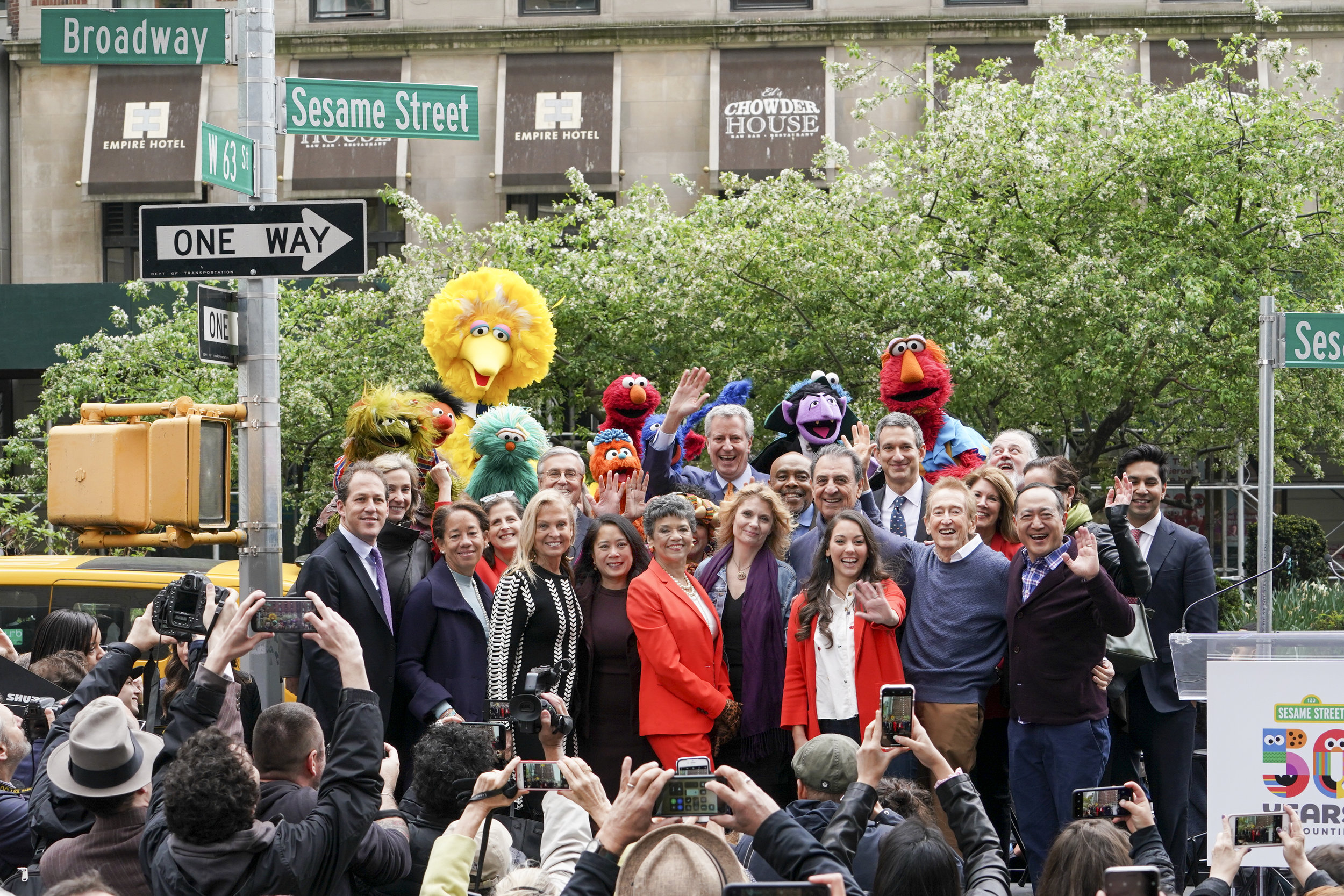 "Street Naming 21 | Richard Termine | Courtesy of Sesame Workshop  In honor of Sesame Street's 50th anniversary, New York City officially named West 63rd Street and Broadway ""Sesame Street"" and declared May 1, ""Sesame Street Day."""