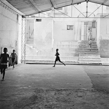 PREPARING FOR THE WRESTLING CLASS, CUBA, 2000  SILVER GELATIN