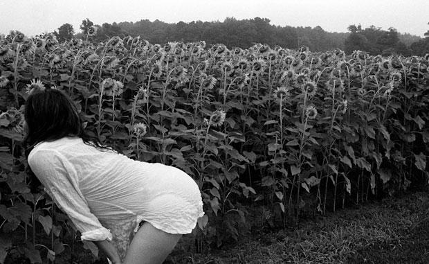SHIRA SMELLING FLOWERS, HUNTINFIELD CREEK INN, ROCKHALL, MD, 2013  ARCHIVAL PIGMENT PRINT