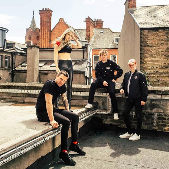 3 degrees today so good time to put up this photo of us in 32 degrees Dublin sun on a roof looking like a metal band that is kinda sick of looking angry . Pic @ruthlessimagery