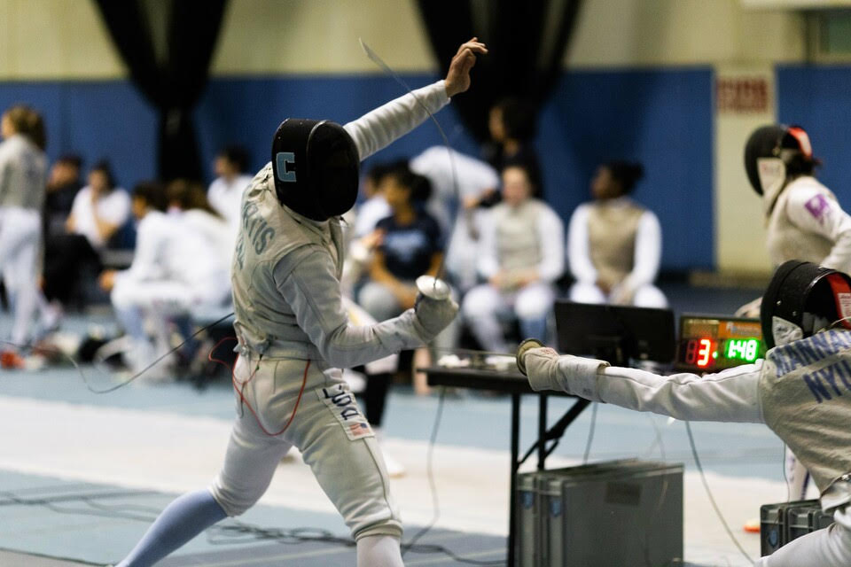 "Columbia men's and women's fencing both took home Ivy League Championship titles last weekend, relying on a system of team work and living by the words that individual fencers are ""never alone."" (Ben Goldsmith)"