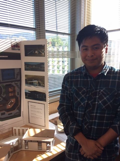 Student Diego Hernandez and his design. Photo by Kathy Green