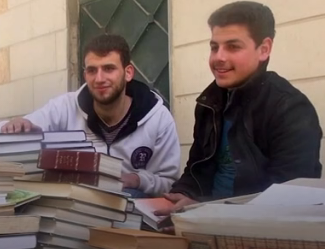 Syrian students collecting books from abandoned buildings.
