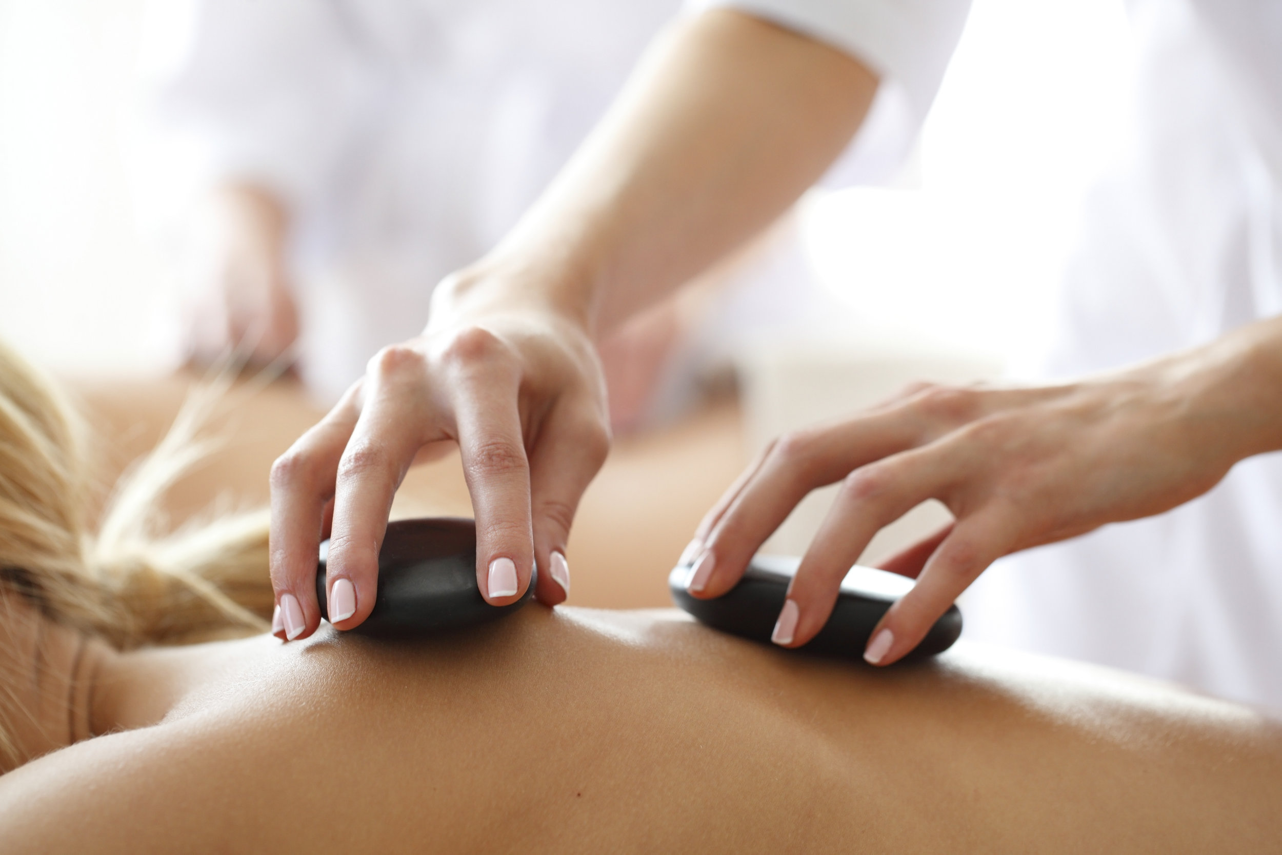 Hot Stone Massage - Hot stone massage therapy promotes deep muscle relaxation through the placement of smooth, water-heated stones at key points on the body. The direct heat of the stones relaxes muscles, allowing the massage therapist to access deeper muscle layers and enhancing the effectiveness of deep tissue massage. Hot stone treatment also improves circulation and blood flow within the body, reduces pain and discomfort during the massage, alleviates stress, enhances mental clarity, and regulates symptoms associated with painful conditions such as arthritis.