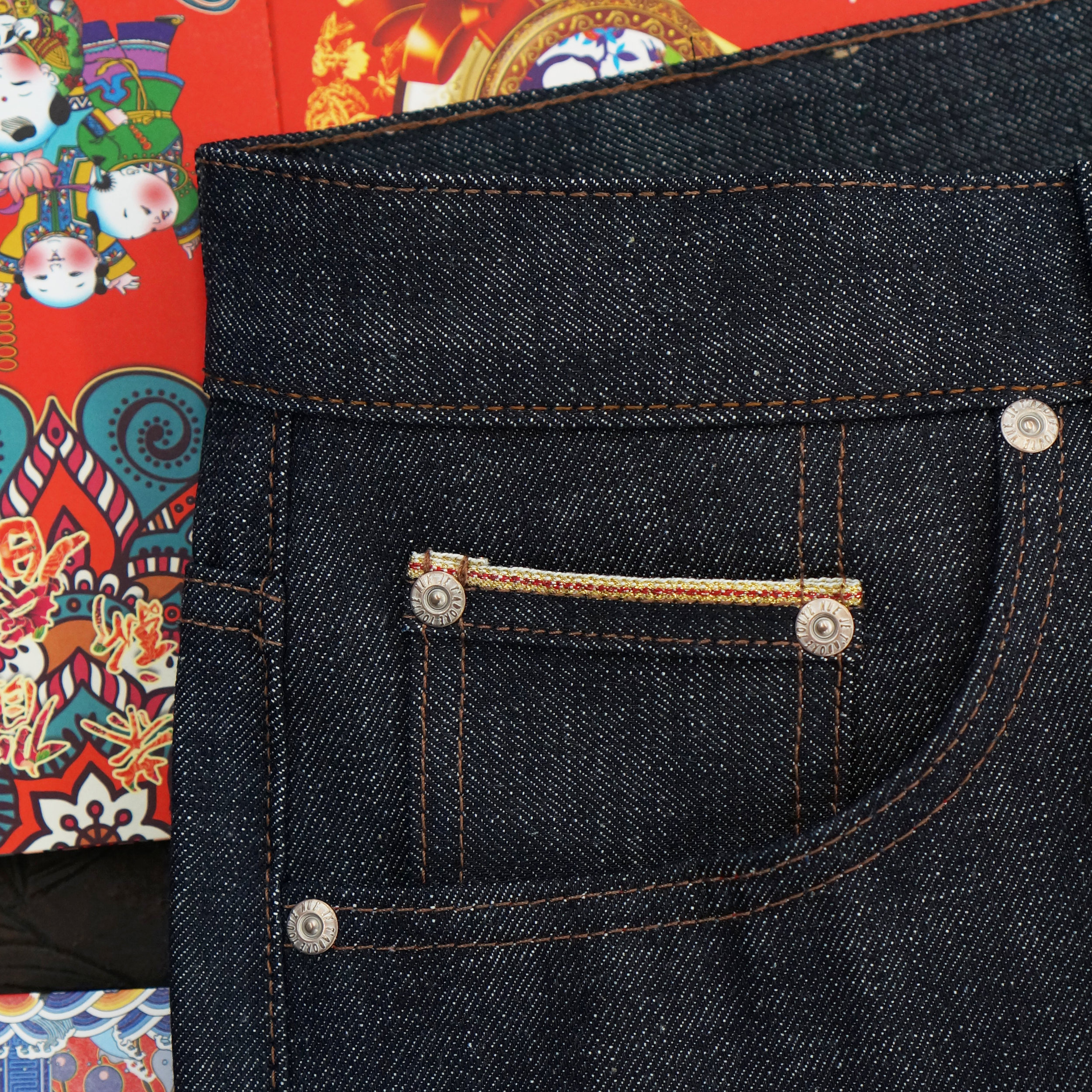 Red and Gold selvedge ID showing on the coin pocket