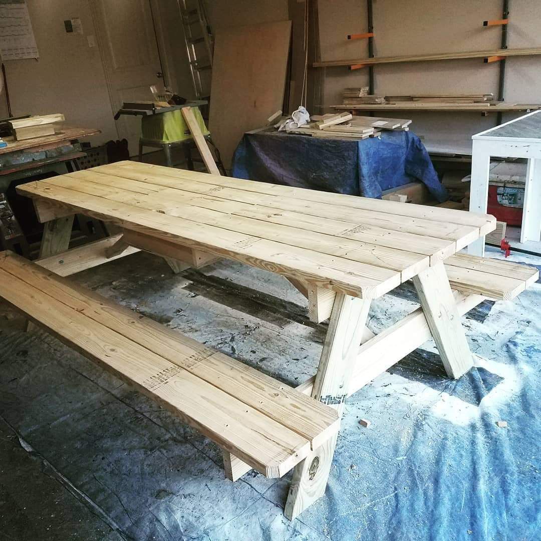 Picnic table with hidden cooler in the center