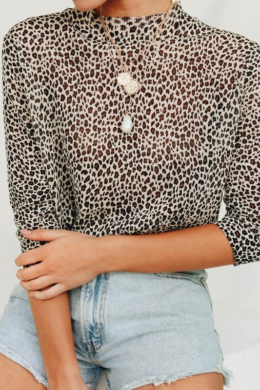 Image Via Verge Girl   https://www.vergegirl.com/collections/tops/products/fearless-femininity-top-leopard