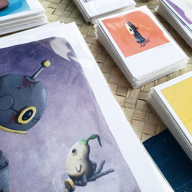 Big stacks of prints for a big crowd. So many people out today! It's a fantastic day to wander around @thebigcrafty. I'm between the chocolate lounge and Vance monument. ⠀⠀⠀⠀⠀⠀ ⠀⠀⠀⠀⠀⠀⠀⠀⠀⠀⠀⠀ #nicholaspecoraro #printsales #horseandhero #bigcrafty #avlartist #avlart #avlartists #donutmonster #828isgreat #artevent #ashevillegallery #asheville #acryliconwood #popsurreal